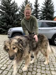 Me with a large Polish dog in Poland