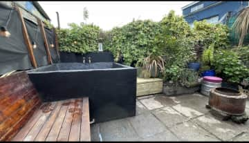 Our back garden with outdoor tub and fire pit.