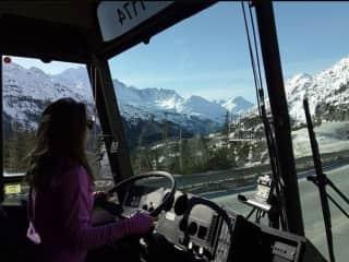 Driving a motorcoach down the an Alaska freeway.