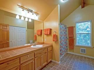 Spacious and bright upstairs bathroom.