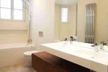 First Bathroom-Toilet, Two Sinks, Tub, Shower