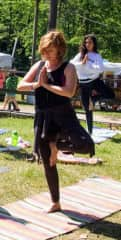 Doing yoga at an art & music festival just a few months post  cancer treatments. Survivor!! Loving LIFE...