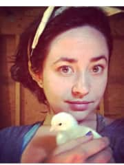 Me with a baby chick on Morning Glory Farm