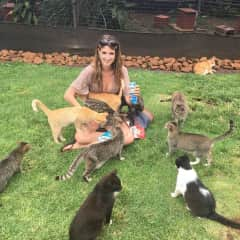 Me at a feral cat sanctuary this summer.