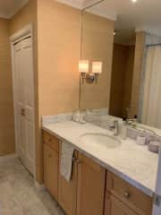 The bathroom has marble counter and floors