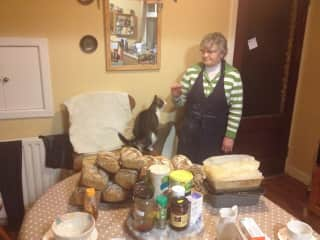 At the house where I grew up, my mother still bake bread watched over by Bella the cat.