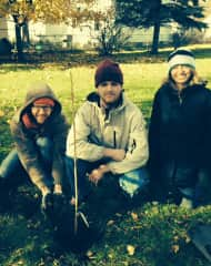 Brooke, Steve, and friend after planting fruit trees in our yard! They do not need any care during the winter.