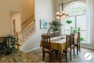 The kitchen and dining area is open and inviting, with lots of natural light.
