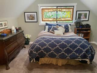 Master bedroom on second floor with a queen sized bed.