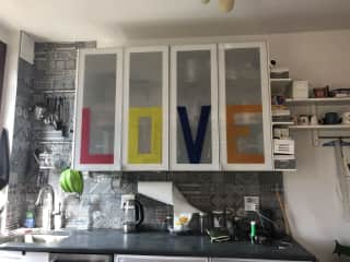 Kitchen in calming grey and white. (And the word LOVE on the cupboards.) There's a farmer's market around the corner every Saturday 9-3.