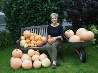 Sylvia and the pumpkins/squash she has grown and loved!