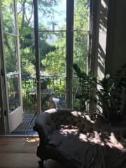 View from the sitting room through the French windows to garden.