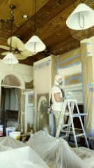 Jon changing the color of cabinetry at one of his properties!