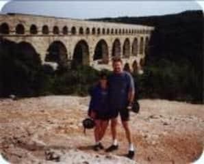 Earl and Paulita biking to the Pont du Gard