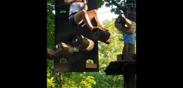 Trying out an obstacle course high in the trees in Ukraine