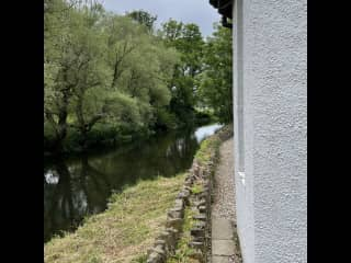 Path along side of the house next to the river.