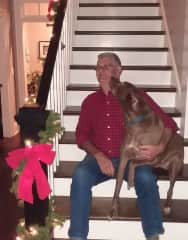 Garry getting kisses from Ace at Christmas 2018 sit in Atlanta GA