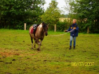 Karen lungeing Gypsy, a friend's pony