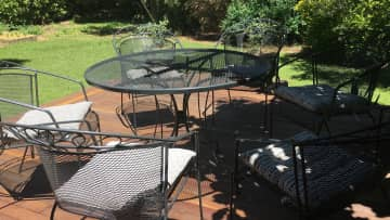 Sunny deck with seating under the magnolia