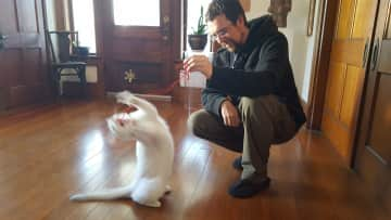 Dustin and a playful Pippen the kitty.
