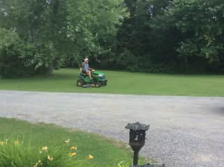 Mike mowing the north 40.