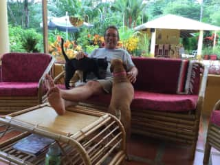 Jim trying to use his iPad in Costa Rica. It's hard when you're a pet magnet, lol.
