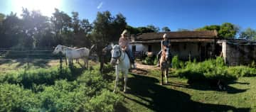 Riding horses with a friend while housesitting a farm in Argentina