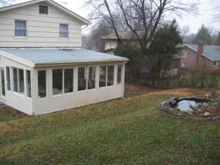 back of sunroom view from yard