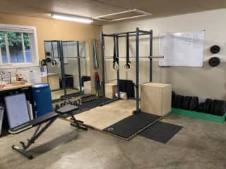 Fully equipped gym in garage.