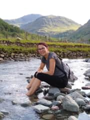 This is me cooling my feet having climbed Scafell Pike in the Lake District