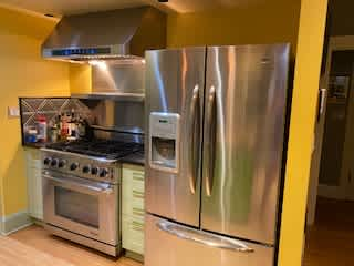Awesome kitchen for cooking including a professional range, hood and warming shelf and an electric convection oven (not shown)