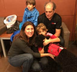 Our family with Mercy the poodle, a service dog we raised and trained