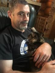 James with Kiwi, our cat.
