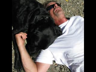 Brian and Paxton napping on the shoreline of the Gualala River.