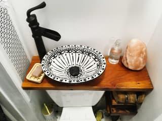 Bathroom : water-conserving sink over toilet