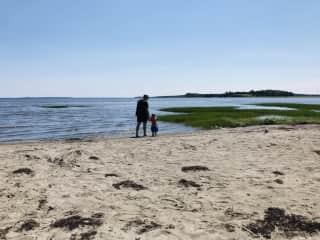 Grandpa and grandson enjoying a walk on a beach near our home.