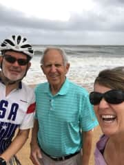Tom, Jill and Tom's dad at the finish of cycling across the US