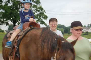Tom and Lori with grandson on Willow
