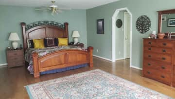 """The upstairs, """"main,"""" master bedroom.  There is a separate shower and jetted tub in the en suite."""