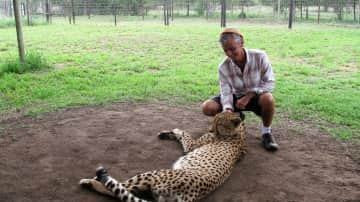 Me, with a big cat, on a reserve in South Africa.