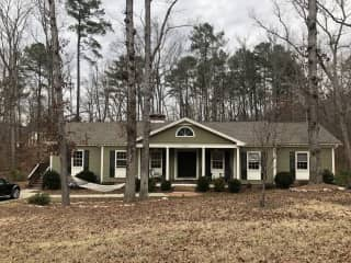 Our sweet ranch house on one acre, surrounded by woods. The house is at the end of a dead-end road, so it's extremely peaceful and private!