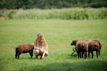 My daughter Katie with some sheep in a field. We love all animals