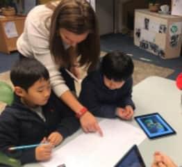 Kristen teaching two of her kindergarten students