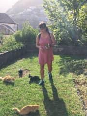 Tracy feeding stray cats in Ravello, Italy