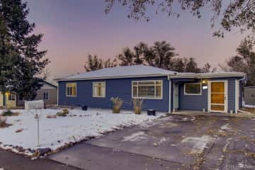 One story home with driveway and 6' privacy fence