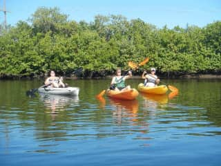 Kayaking with friends. I am in tghe middle