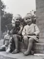 My brother and me with Toodles our first pet