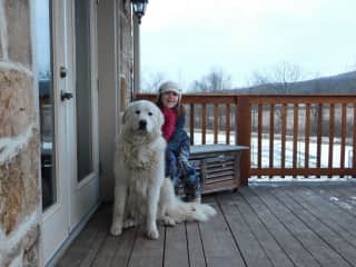 Our daughter with Rose, the livestock guardian dog.