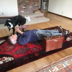 """Phil playing with one of our """"Rover.com"""" clients."""