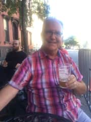 We love to explore neighborhoods and experience local foods, farmers markets, craft breweries etc.  Larry is enjoying a craft beer at a street festival in Brooklyn